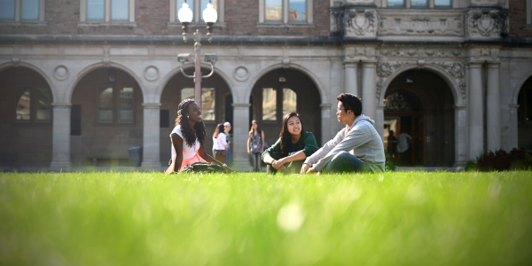 students sitting on campus