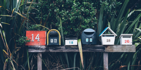 row of six mailboxes